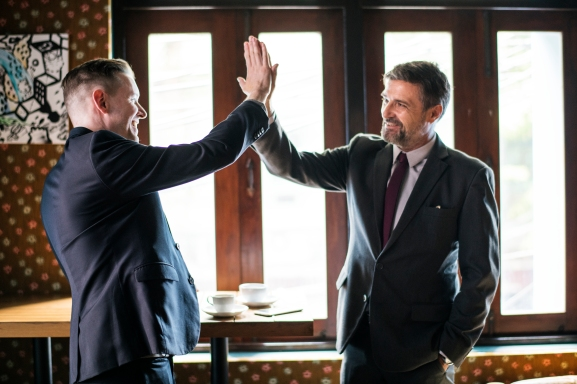 Businessmen giving a high five